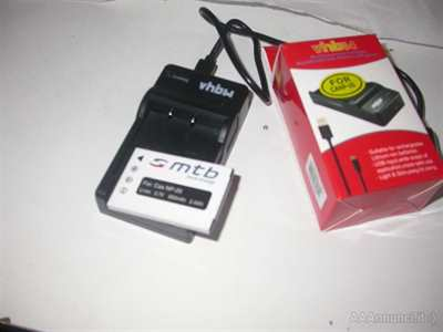 Carica bateria per foto camera np20 + batteria nuovo