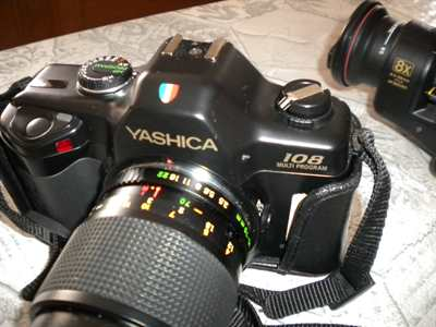 Yashica 108 multi program con obiettivo